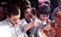 The boys are definately keen on the hired chocolate fountain at a Melbourne birthday party.