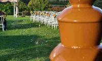 A chocolate fountain inside looking out at the picturesque setting for the wedding.