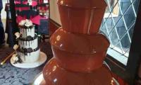 Waiting for the guests to arrive and enjoy the chocolate fountain which compliments the setting at this wedding.